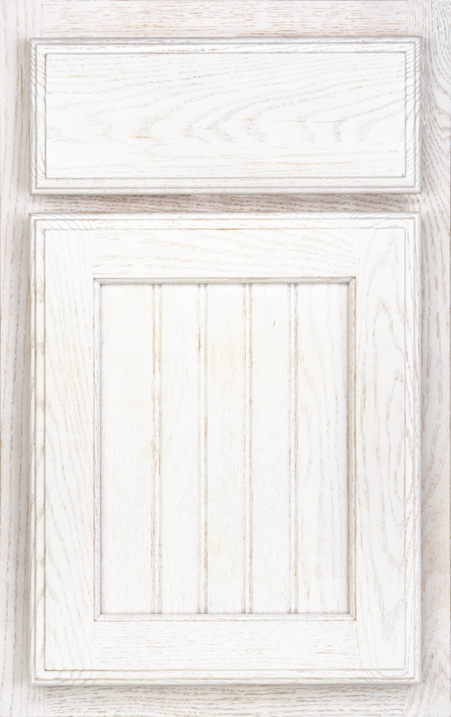 Country Cabinetry, Higgins with a beadboard center panel on oak & painted Cottage White